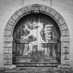 The dragon is coming .. or winter? (Tomsch) Tags: dragon drache winter wintertime door entrance tor tür eingang blackandwhite schwarzweiss bw sw square squareformat graz austria österreich styria steiermark landhaus street streetphotography travel reisen traveling