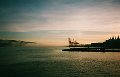 Vancouver harbour (KD6-3.7) Tags: vancouver harbour remembranceday november water sunrise fog olympusmju1 200asa expired pointandshoot prime f35 infinitystylus industrial docks cranes