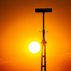 Perfect Circle (MAKER Photography) Tags: canon eos 7d sunset sun down orange golden hour antenna circle munich germany flat society silhouette