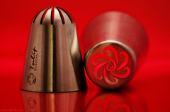nifty nozzles (sure2talk) Tags: macromondays hobby niftynozzles russian russianniftynozzles cakedecorating red reflection stainlesssteel nikond7000 nikkor85mmf35gafsedvrmicro macro closeup