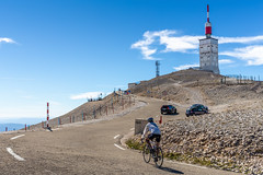 Biker cycling to the hill of Mont Serein Ventoux (jack-sooksan) Tags: bike biker ride vehicle cycling bicycle road street way hill slope mountain mount montsereinventoux provence france sault travel journey local rural europe curve rock stone desert track trail route transport sport summit peak sand landmark blue tower building lighthouse landscape sky