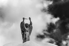 Defend Us in Battle (Melody Migas) Tags: biloxi ms mississippi stmichael stmichaelcatholicchurch architecture belief church clouds faith gulfcoast gulfcoastcatholicchurch religion saint sky statue outside bw black white blackandwhite mono