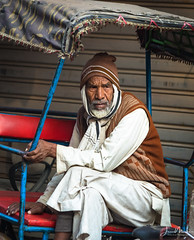 Rickshaw Driver Old Delhi (Wits End Photography) Tags: rickshaw streetportrait travelphotography delhi adult india people guy male man street streetphotography places men drive pavement road roadway route