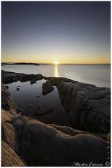 181125 112web (Marteric) Tags: lerkil sunset bohuslän sweden ocean sky water sunburst sea rocks reflection mirror nature outdoor blue sun