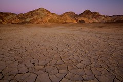 Dusk From the Floor of Death Valley (Alan Amati) Tags: amati alanamati america american usa us ca california death deathvalley valley np national nationalpark deathvalleynationalpark floor dusk sunset mountains glow earth shadow chacks mud wash basin cracks pattern texture landscape desolate desert nature natural ground