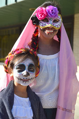 A skeleton and her mother (radargeek) Tags: dayofthedead 2018 october plazadistrict okc oklahomacity facepaint catrina kid child flowers portrait skeleton mask