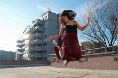 jump (jorwudi) Tags: circle hair legs leg february sun trees buildings turn roof girl round arms tattoo knee sky milan jump