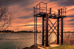 standing tall (stevefge) Tags: 2019 beuningen gelderland waal waalstrand structures steel ladder glow landscape water rivers red reflections reflectyourworld sky trees bomen horizon shore abandoned nederland netherlands nl nikon sunset uiterwaarden
