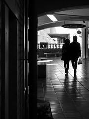 Walk close together... (明遊快) Tags: urban step building winter monochrome bw couple sunlight shadows reflection japan hallway candid achitecture