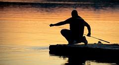 Il pescatore guerriero - The warrior fisherman ... (silvio francesco zincolini) Tags: sunset varese lake water people pier