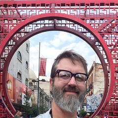 Selfie in Mexico City's chinatown. (swampzoid) Tags: barriochino chinatown mexicocity circle self selfie selfportrait man glasses gayman square red design smile swampzoid beard hairy face over50