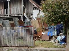 Messy Yard (mikecogh) Tags: luangprabang house wooden mess yard clothes drying corrugatediron sheets rust