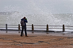 Getting the photo (Croydon Clicker) Tags: photographer person woman sea ocean wave splash fence road newhaven eastsussex sussex