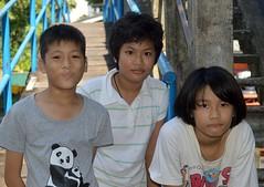 children at the foot of a bridge (the foreign photographer - ฝรั่งถ่) Tags: three children kids bridge khlong thanon portraits bangkhen bangkok thailand nikon d3200