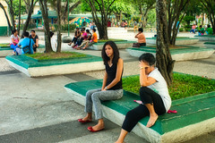 Park Life (Beegee49) Tags: street women sitting waiting park filipina happy planet sony luminar a99 deep thought silay city philippines asia