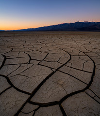 Sunrise On The Mud Flats (Travis Rhoads) Tags: california deathvalleynationalpark mudcracks travisrhoadsphotography copyright2019 thegoldenhour textures sunrise dawn nikcollectionbygoogle nationalpark mountains landscapephotography goldenhour desert tvc33 bh55 rrspcl01 ba72l reallyrightstuff sony1635f28gm sonyilce7rm2a7rii 2019 focusstacking