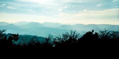 Faded Mountains (Sebastian Schmidt) Tags: sebastianschmidt landscape mountains trees sky clouds sun sunlight outdoor outside nature