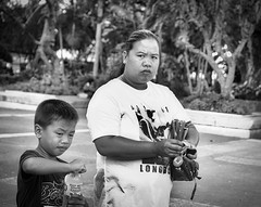 Serious Looks (Beegee49) Tags: street mother child son boy serious happy planet luminar sony a6000 blackandwhite monochrome bw silay city philippines asia happyplanet asiafavorites