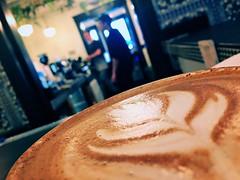 over coffee (Chris Blakeley) Tags: seattle hipstamatic coffee mocha latteart coffeeart eldiablo candid cafe coffeehouse