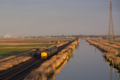 37425 Haddiscoe 19/02/19 - Daybreak over the Norfolk Broads as 37425 and 37423 charge towards Haddiscoe with the early morning ECS to Lowestoft. The railway runs parallel to the New Cut, which connects the river Yare and Waveney. (rhayward92) Tags: 37425 class 37 drs direct rail services haddiscoe 5j67 ecs tractor greateranglia sunrise