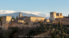 Alhambra Palace from Calle Santa Isabel la Real, Granada (john@johnrobertsimages.co.uk) Tags: castle building old andalusia andalucia city cityscape hill granada mansion alhambra fortress spain palace travel tower outdoor medievalarchitecture architecture landscape callesantaisabellareal landmark outdoors fort europeanunion fortification outside es