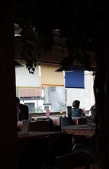 (kaliak) Tags: ricohimagingcompanygr window silhouette backlit backlighting figures restaurant table chair