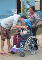 Visit With Grandma (peterkelly) Tags: digital canon 6d northamerica cuba cubalibre gadventures viñales wheelchair family blue street road old woman