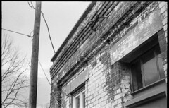 beautifully worn brick and stone facade, commercial architecture, River District, Asheville, NC, Kodak Retina IIIc, kodak tri-x 400, 4.7.19 (steve aimone) Tags: architecture urbanlandscape urbandecay brick worn powerlines riverdistrict asheville northcarolina kodakretinaiiic retina kodaktrix400 hc110developer 35mm 35mmfilm film blackandwhite monochrome monochromatic