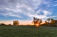 Pasture at Dawn (Daniel Q Huang) Tags: sunrise grass sunstar trees landscape sky coulds outddor