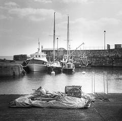 Carnlough Harbour (fudgefishmono) Tags: ilford hp5 ddx fujifilm mf mediumformat gf670 blackandwhite analog selfdeveloped scanned harbour irishsea clouds epson scan v550 perfection bwfp