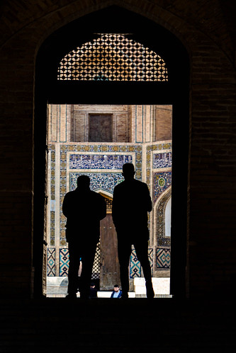 The Mir-i-arab Madrassah seen beyond the doors of the Kalon Mosque, Bukhara, Uzbekistan