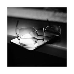 Shiny Ones (Thomas Listl) Tags: thomaslistl blackandwhite biancoenegro noiretblanc monochrome square glasses glass mirror reflecion phone mobilephone table office light contrasts grey grain 50mm