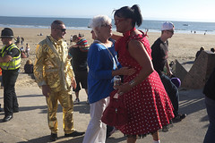 About to embrace (kevin Akerman) Tags: women embrace gold golden beach seafront porthcawl elvis festival
