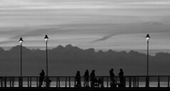 People on the bridge in the night (Darea62) Tags: blackandwhite street streetlights clouds sky bw blackwhite outside mood marinadimassa tuscany biancoenero minimal leisure