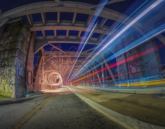 gateway to a different dimension (Wizard CG) Tags: cumberland basin bristol hotwells ashton harbourside railway bridge lines metal beams iron girders railings barriers geometric epl7 road studs evening lights outdoor architecture column longexposure olympus nightshots