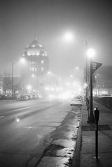 Champaign City Building (dvlmnkillatron) Tags: 35mm film kodak bw selfdeveloped analog night evening champaign kodaktmaxp3200 pushed 6400 fog street architecture traffic champaigncitybuilding
