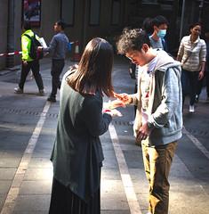 Admiring SHINY (wawrus) Tags: central hongkong cny jade bracelet bangle couple mobile sunlight shadows mood holiday shopping new
