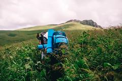 through a grass (showpx) Tags: gras backpack tourism tourists campaign grass summer mountains nikon d600 sigma35 clouds