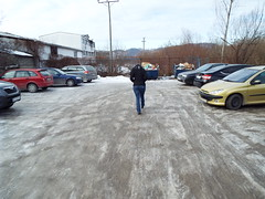 Car Park or Ice Rink?? A cold day in Kostajnica Bosnia (sean and nina) Tags: ice fros cold freeze freezing kostajnica bosna bosnia bih republika srpska serb winter january 2019 border town bosnian municipality nina wife married fiancee girlfriend girl lady woman female beauty beautiful gorgeous stunning charm charming cute brunette black clothes jeans blue brown eyes face pink lips sun car park cars vehicles outdoor outside weather candid street public people person