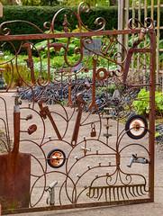 Eccentric garden gate (maytag97) Tags: maytag97 nikon d750 theoregongarden garden gate unique eccentric rust ornate outdoor outside tool tools rake shovel wrench creative