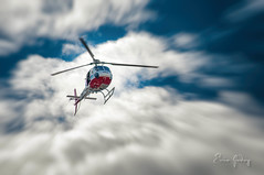 Helicopter 1 (Enio Godoy - www.picturecumlux.com.br) Tags: bluesky police nikon nikond300s helicopter flying sky analogefexpro2movement1 baurusp niksoftware d300s clouds