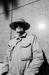 Sun hat (chrisrodriguez16) Tags: ricohgr2 28mm streetportrait blackandwhiteportrait
