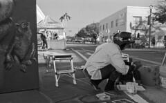 Under Monkey's Gaze (PositiveAboutNegatives) Tags: leica leitz leicaflex leicaflexsl slr 35mm leicar 11231 35mmelmarit film blackandwhite artist painter streetpainting bw blackandwhitefilm foma fomapan fomapan100 rodinal coolscan lakeworth florida analog