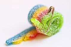 Damaged/Iridescent Candy ;-) (eleni m) Tags: macromondays picktwo damaged macro candy iridescent safetypin hmm hk colours
