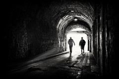 side by side (Daz Smith) Tags: dazsmith fujifilmxt3 xt3 fuji bath city streetphotography people candid portrait citylife thecity urban streets uk monochrome blancoynegro blackandwhite mono men silhouettes light runners silhouette tunnel
