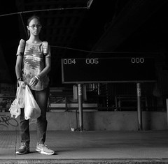 Waiting at the pier (Zebedee_69) Tags: streetphotos streetphotography streetscene candid portrait bangkok thailand thai blackandwhite bnw bw people streets streetlife streetimages woman girl beautiful cute waiting pier boat publictransport