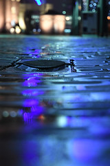 Blue Drain (Coquine!) Tags: christianleyk bremerhaven germany deutschland night nacht reflections spiegelungen blue blau light licht pavement kopfsteinpflaster puddles pfütze