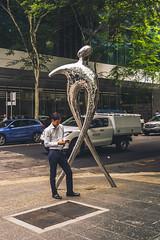 Man + Monument (Leighton Wallis) Tags: sony alpha a7r mirrorless ilce7r 55mm f18 emount 1635mm f40 brisbane qld queensland australia sculpture man phone pose