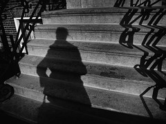 A sunny day in March (Ageeth van Geest) Tags: woman shadow coat zwartwit monochrome blackandwhite bw silhouette street stairs