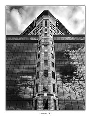 Symmetry (Danial C Thiessen) Tags: photography calgary black white blackwhite monochrome alberta canada city citylife architecture symmetry symmetrical reflection reflected cloud clouds sky building tall outside outdoors brick glass texture
